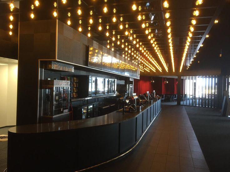 Reading Cinema, located in the Brickworks complex New Lynn. 16 metre ticket counter, with custom steel paneling, Brass foot rail and Caesarstone Worktop. Backwall concessions includes steel framework for fridges and slatwall to the ends.