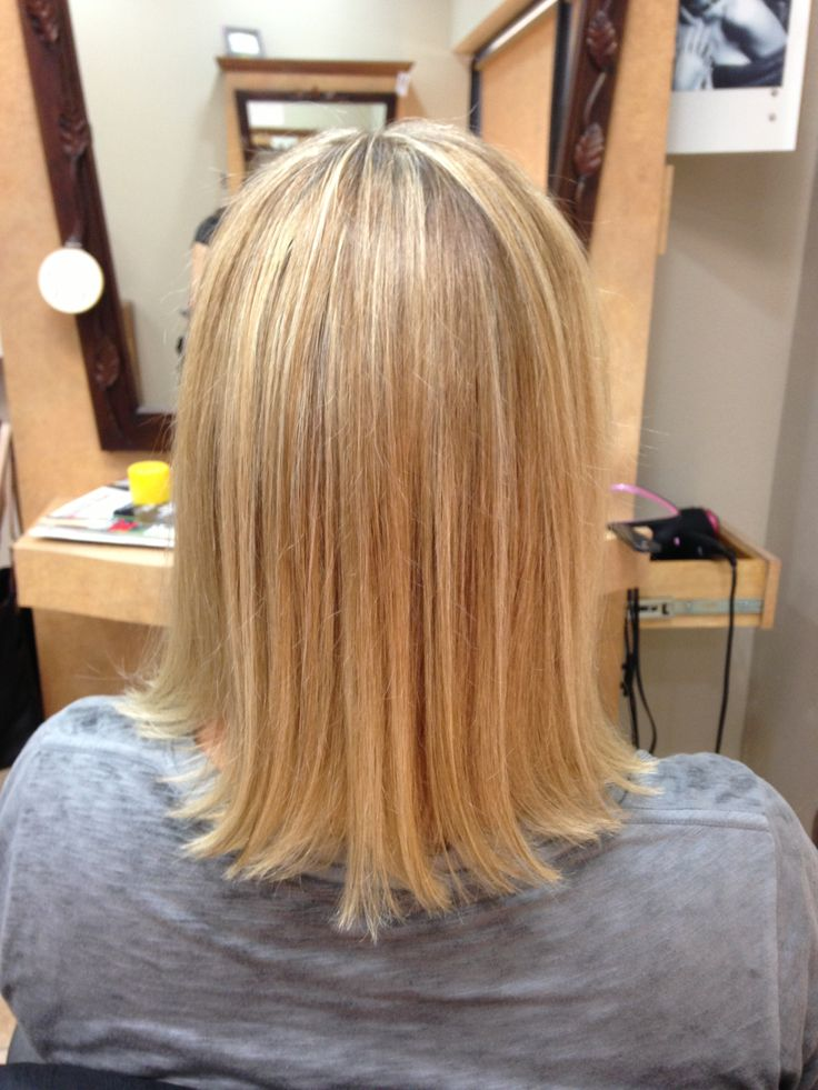 back view of blonde hair with honey color lowlights by