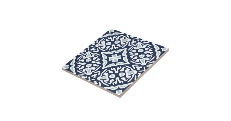 Accent your Mediterranean style decor with these ceramic tiles featuring an intricate geometric pattern in coastal navy blue, sky blue and white inspired by the traditional azulejo tiles of Spain and Portugal.