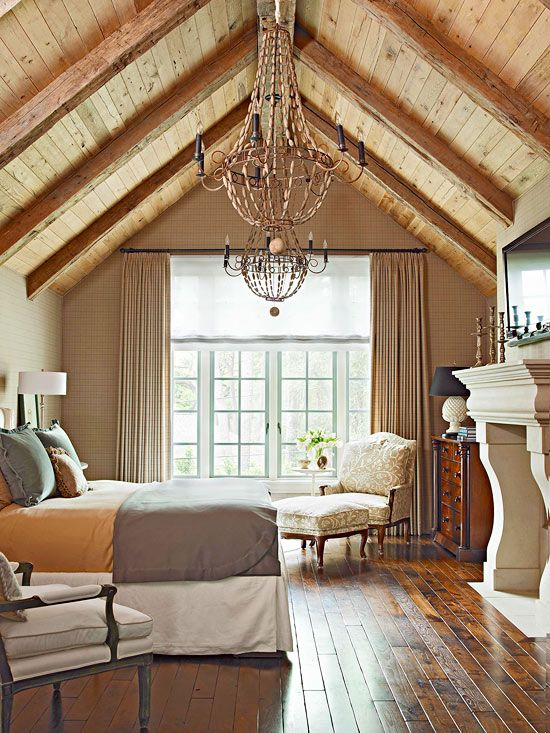 Love the vaulted wood-beam ceiling and all the natural light from the huge windows!