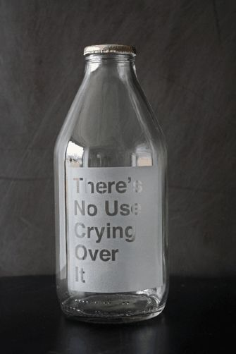 This traditional glass milk bottle has been etched with the words 'There's no use crying over it' playing on the saying 'There is no use crying over spilt milk'.