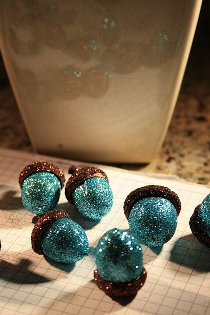Glitter acorns! in any color, maybe gold or ivory.