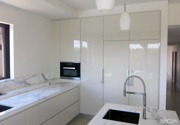 """A GELOSA kitchen finished with a high gloss polyurethane - Colour - Dulux """"White Duck Half"""" & Calacatta Marble. Miele appliances"""