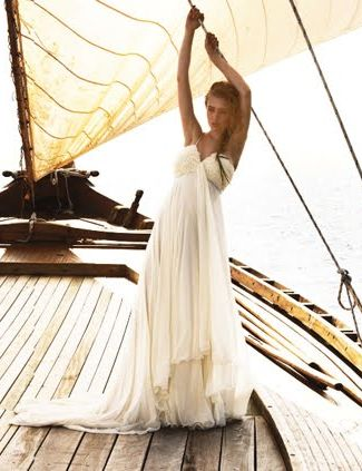An intimate wedding aboard a vintage wooden sailboat.