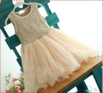 Your princess will look so glamorous in this  beautiful dress featuring gold sequined bodice and a  cream tulle skirt  2 in size 2 - one in size 3 available -  May be available on request in other sizes MONEY BACK GUARANTEE - see our terms and conditions  Flower girls dress - Suit small child or junior bridesmaid   BUDGET BRIDAL FLOWERGIRL