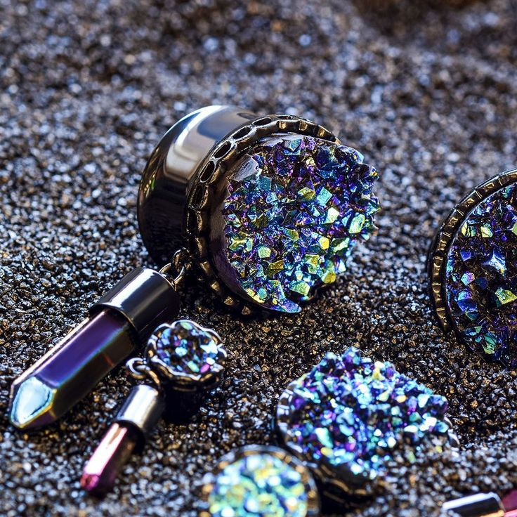 "Synthetic blue druzy black anodized surgical steel double flared plugs. Available in 2G to 1""."