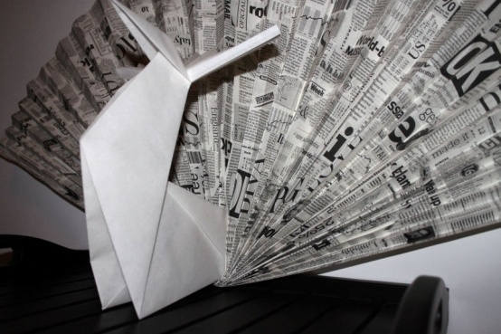 origami peacock with newspaper pattern