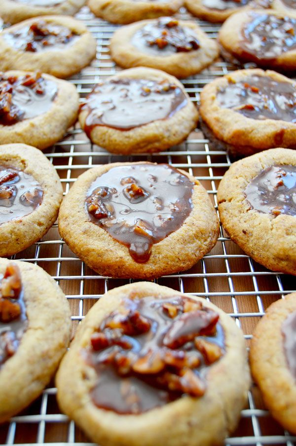 Kentucky Derby Cookies - pecan shortbread thumbprints filled with pecans, bourbon, and chocolate. A fun take on the traditional Derby Pie. Perfect for parties! | www.theHungryTravelerBlog.com
