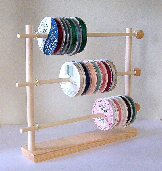 Now you can organize your favorite ribbons spool after spool without a tangled mess! This adorable spool ribbon holder is made of solid wood, holds 50+ spools (depending on size) right at your finger tips. Your spools set neatly on 3 rows of racks, simply remove by sliding your spools across the wooden dowels, dispense by pulling the ribbon tails. Thats all to it. Made not to take up a lot of space. Ribbon holder measures 13 long x 12 tall x 2 1/2 wide. Dowel diameter is 5/16. TOTALLY…