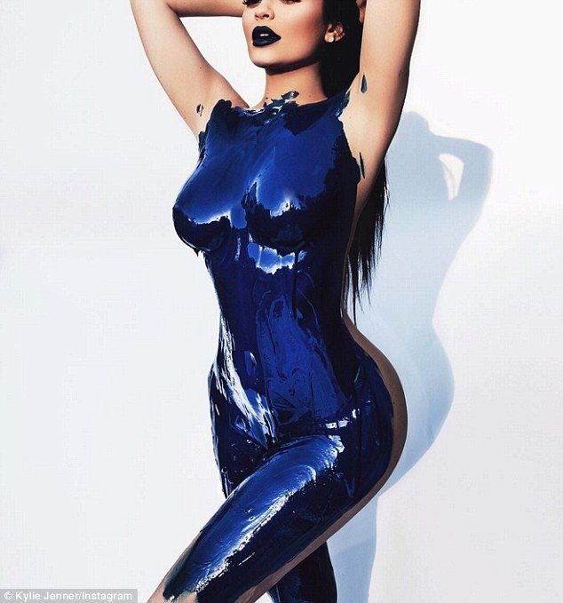 Raunchy: Kylie Jenner wears nothing but blue body paint in a sexy new image she shared to Instagram on Tuesday