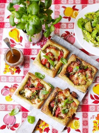Vegetable tartlets   Jamie Oliver  Ingredients 1 x 500gblock of ready-made puff pastry plain flour, for dusting 4teaspoonspesto 1handful ofmixed, ripe cherry tomatoes 8asparagus spears 4baby courgettes 2-3jarred roasted peppers ½a bunch offresh basil olive oil 8black olives, optional 1 x 100gball mozzarella 20gParmesan cheese, optional  Read more at http://www.jamieoliver.com/recipes/vegetables-recipes/vegetable-tartlets/#o1JMs7ty8igBijBC.99