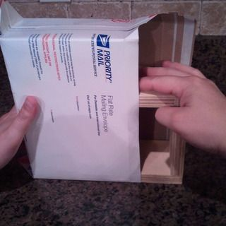 Make a $4.75 shipping box from a flat rate envelope.