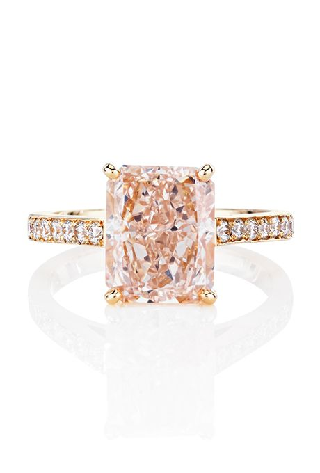 A pink radiant-cut diamond engagement with white diamond pavé set in rose gold by @debeersofficial | Brides.com
