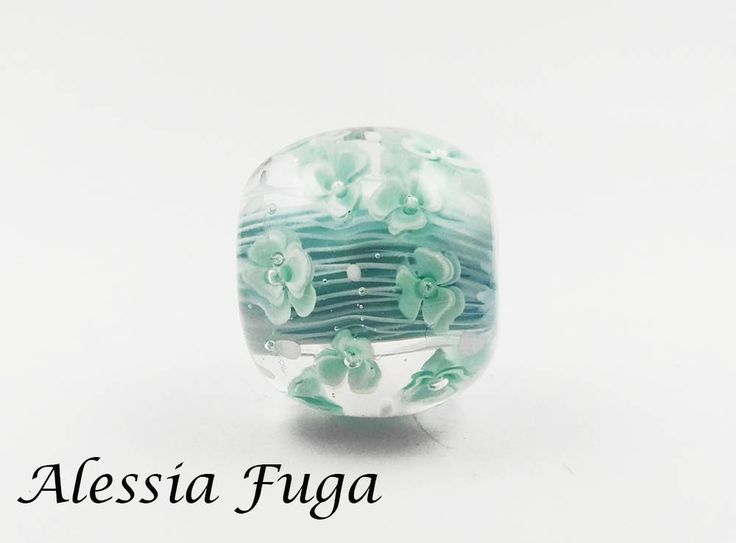 OOAK focal lampwork glass bead in light turquoise and teal decorated with flowers di alessiafuga su Etsy