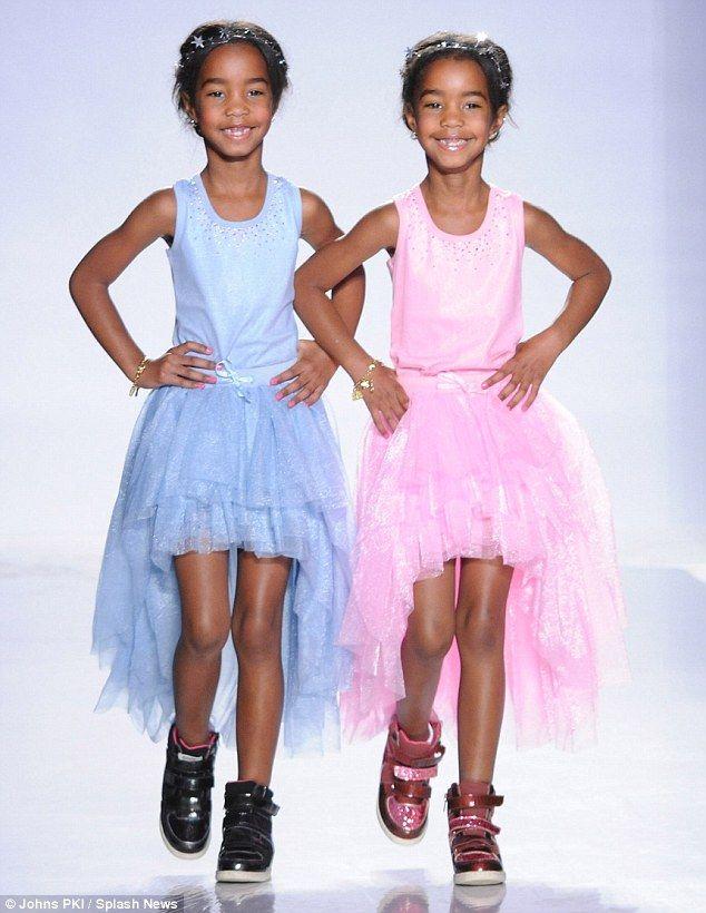pdiddys twins dlila and jessie walk the runway at the swarovski childrens