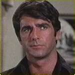 SAM ELLIOT:  OMG.. he is gorgeous. I have never seen Sam without any facial hair.