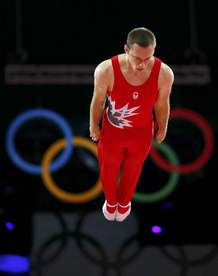 Jason Burnett of Canada competes in men's gymnastics trampoline qualification in the North Greenwich Arena during the London 2012 Olympic Games