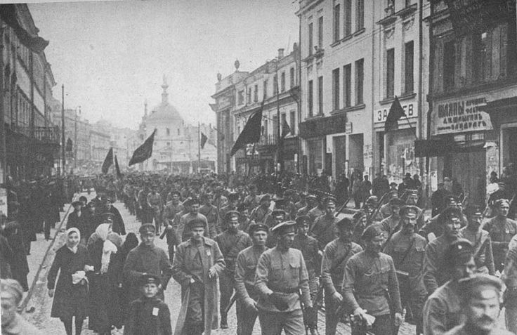 Throngs of soldiers and workers march on St. Petersburg in the Bolshevik Revolution, October 1917. EC