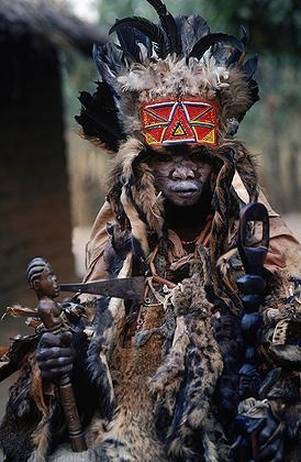 A good, benevolent witch doctor,or bwanavide, dressed for a healilng ceremony in the village of Kikondja in eastern Congo