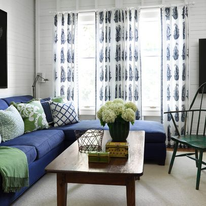 Navy Blue Sofa With Light Rug And Walls