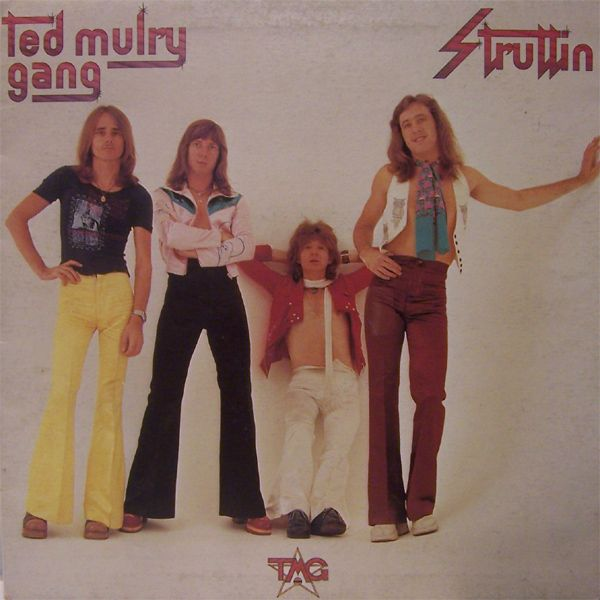 Australia's celebrated 1970's group Ted Mulry Gang (or TMG, as they were commonly known among fans-if you couldn't abbreviate your band name you just weren't cool or hip). They had an album titled 'Struttin' in 1976 featuring the band innocently hanging out with their cool 70's get up. Made for a damn fine album cover, and today it's a fantastic snapshot of fashion days gone by.