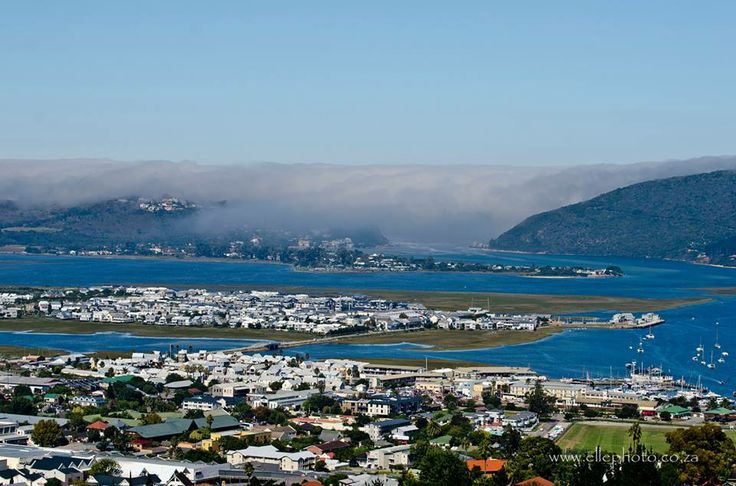 Beautiful image of the mist rolling in over the Knysna Heads, by elle photography