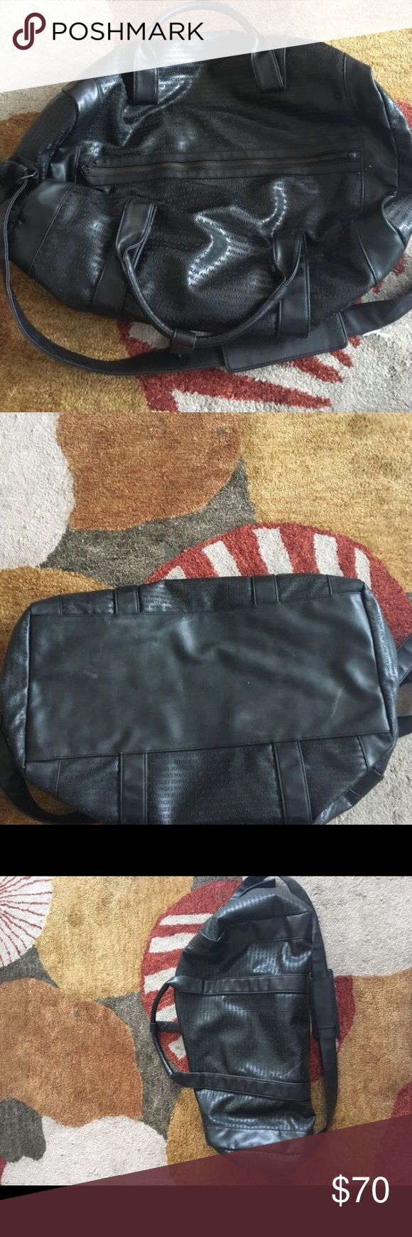 Armani Exchange Black Duffle Bag. In amazing condition black Armani Exchange duffle bag with shoulder strap. 100 percent vegan leather. Styled with Armani Exchange Established Nineteen NinetyOne across the bag. Classic and sporty and great for anything. A/X Armani Exchange Bags Duffel Bags
