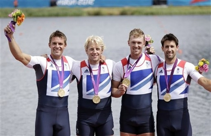 Andrew Triggs Hodge, Tom James, Pete Reed and Alex Gregory celebrate on the podium.