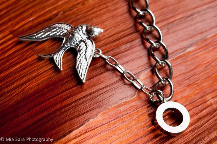 Anchored bird charm detail