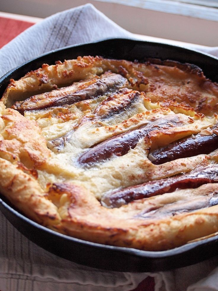 Toad in the Hole Recipe - Sausages packed into a fluffy pancake batter.