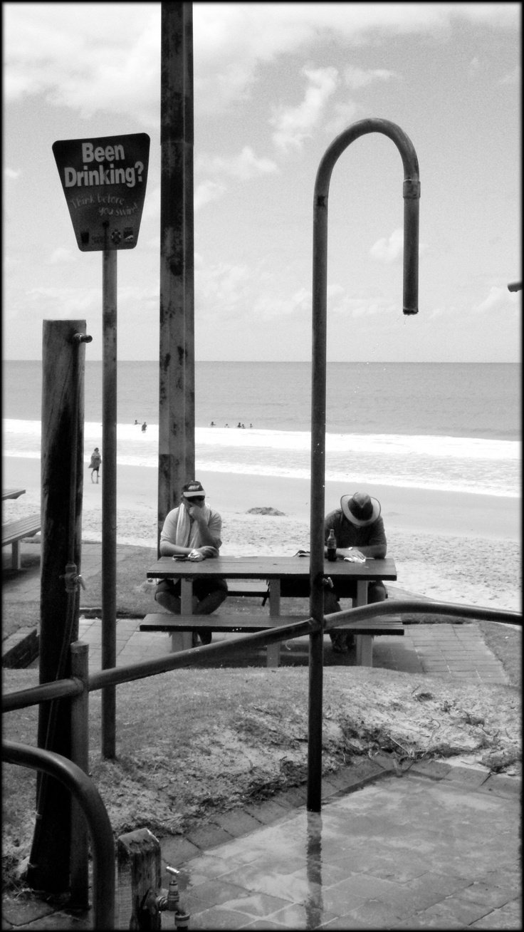 Two old guys having a drink by the beach,Queensland, Australia.