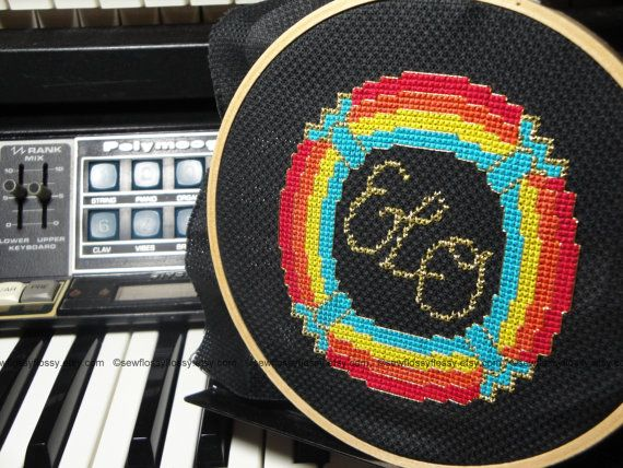 $60 COMPLETED CROSS STITCH - Electric Light Orchestra  (ELO) Spaceship Band Logo Jeff Lynne made by SewFlossyFlossy.  #ELO #electric_light_orchestra #jeff_lynne #spaceship #band #logo #cross_stitch #cross_stitch_pattern #art #shirt #t_shirt #poster #embroidery #embroidery_hoop #wall_art #pop #pop_art #synth #syntheziser #70s #80s