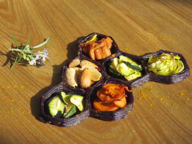 """We made a """"primavera"""" appetizer: we printed a divider dish made of purple potato to separate our lightly sautéed spring vegetables and almonds."""