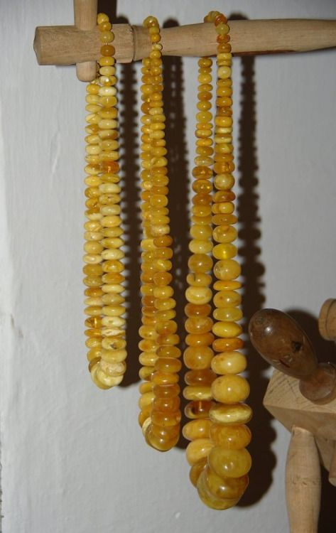 Amber necklaces, worn by the women from the region of Kurpie Zielone, Poland [source].