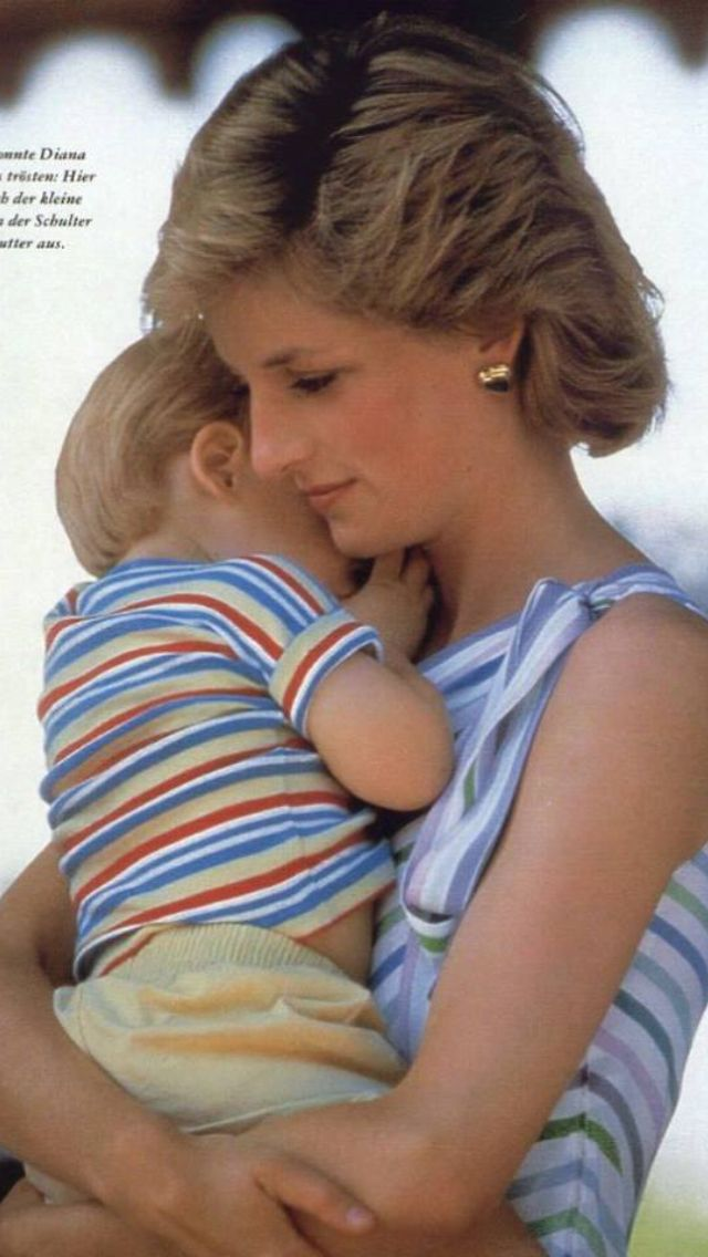 Princess Diana holding Prince Harry.