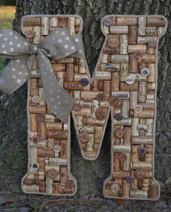 Large Wine Cork Letter M trimmed with sisal rope with removable decorative bow hangers on back