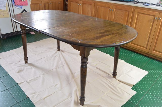 Take a scratched and beat up thrift store table and bring it back to life with a coat of glossy fresh paint.
