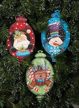 Portrait ornaments ~ I'd make them more like frames, with baubles on top & bottom like these, then stick a character or critter inside, but they could hang over the edges, too!