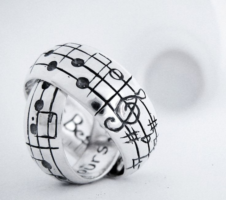 I love this!  Your Song Wedding Bands - High End - Sterling Silver - Personalize - Made to Order - Real Music matches your song. $395.00, via Etsy.