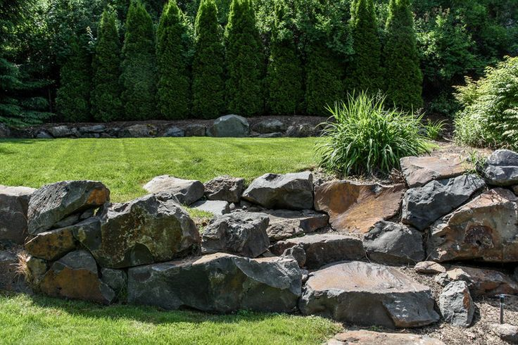 boulder retaining wall and natural stone steps