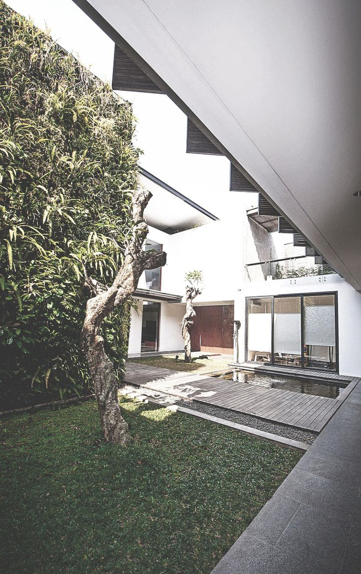 Sister House Image 8. Project : 2628 Sister House Location : Bandung, Indonesia Site Area : 597 m2 Building Area : 600 m2 Design Phase : 2011 Constrution Phase : 2011 - 2013 Description : 2 houses being designed as one building with 2 families live there.  #architect #bandung #jakarta #architectindonesia #archdaily