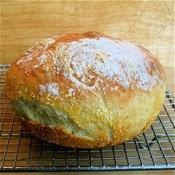 Pan:750 ml agua tibia 1 ½ levaduras T. granulados  1 ½  sal gruesa 650g de harina blanca:Mezcla el agua tibia con la leva+sal despues+harina de golpe mezclar no amasar.La masa sera humeday flojaq (se adapta al recipiente)Dejar reposar tapada 2h .Se puede usar o refrigerar toda la noche.Espolvorear con harina y formar el pan como doblado,dejar descansar al descubierto 40min. Calentar el horno y el recipiente. colocar el pan y acompañar de un recipiente con agua.30min.