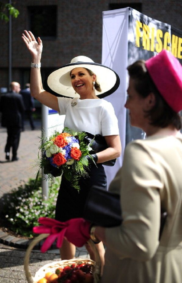 Queen Maxima of the Netherlands waves to the public outside the Marinekompetenz Zentrum Leer on 26.05.2014 in Leer, Germany.