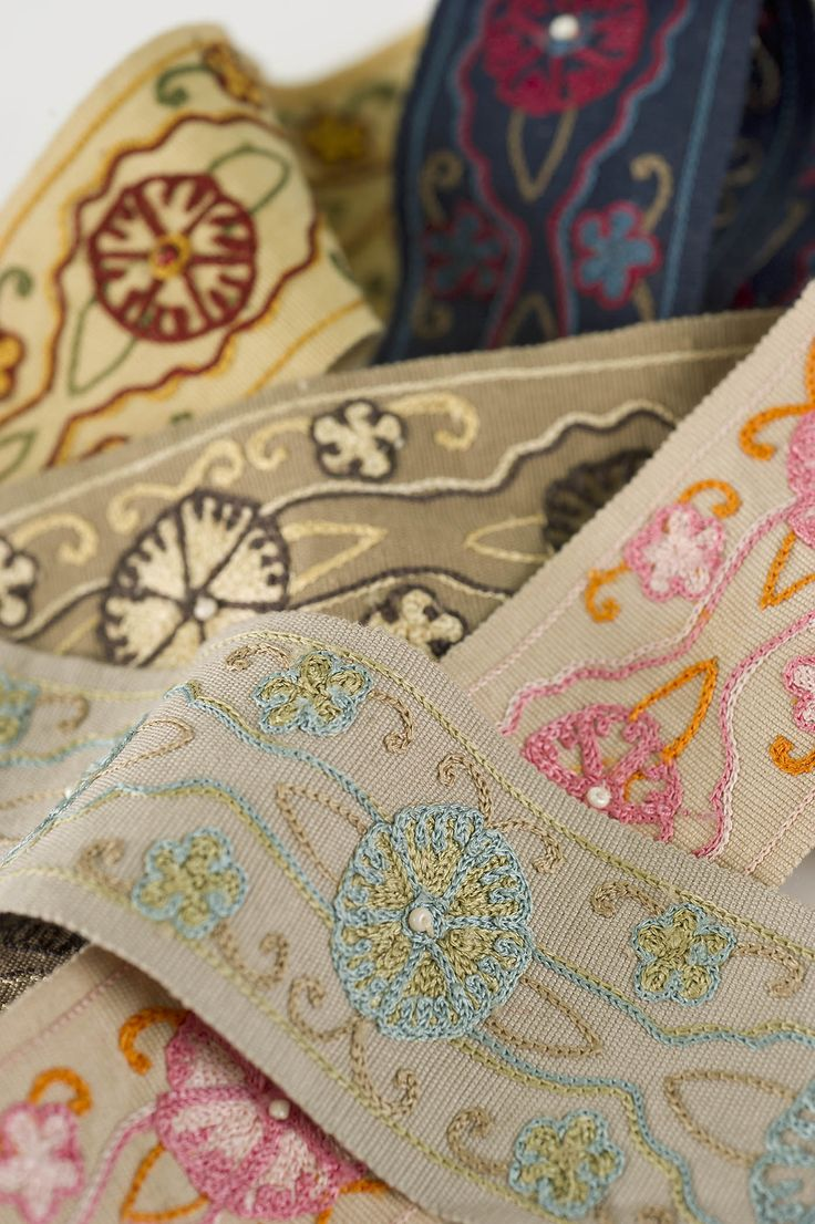 Borders, Braids & Tapes: Tiegs – A beautifully embroidered floral and scroll design embellished with delicate seed beads. #fabricut #trimmings