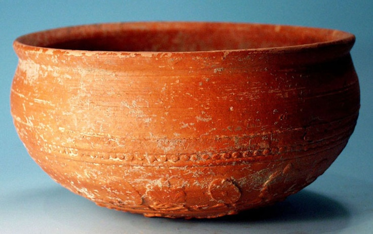 Hellenistic Megarian Ware Vase.   An ancient Hellenistic Greek Megarian ware red glazed bowl with molded relief decoration in the form of palmettes and oval Celtic shields. Athens or Corinth, circa 3rd-2nd century BC