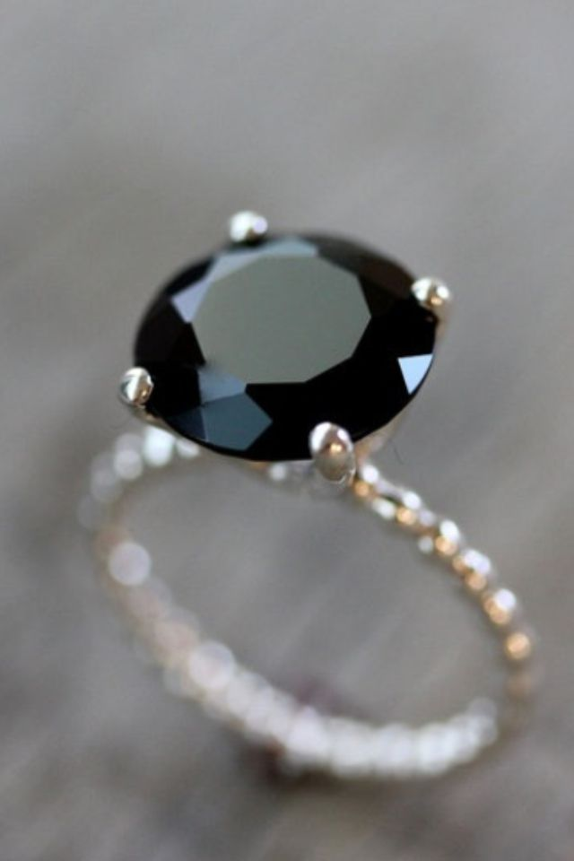 This engagement ring is so unique! It really makes a statement! For 6 more incredibly unique rings - check out our blog!