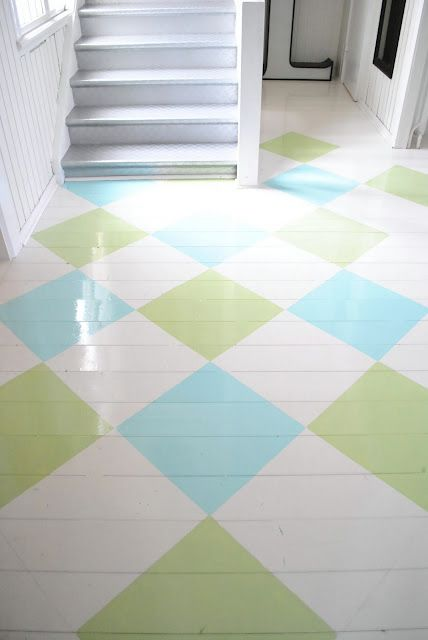 painted floor... love! Paint and seal the sub flooring in playroom and laundry room. Bright and happy.