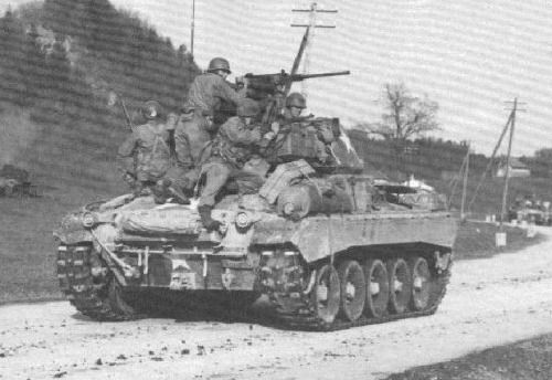 "American light tank M24 ""Chaffee"" (M24 Chaffee) with troops on Board, Northern France, late 1944."