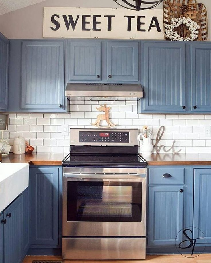 i spy our embossed sweet tea sign above these gorgeous blue kitchen cabinets thanks - Blue Kitchen Cabinets