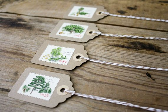 A set of handmade gift tags featuring vintage postage stamps.